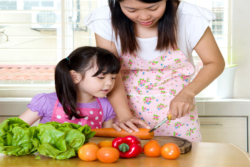 Mom teach Daughter to cook veggies