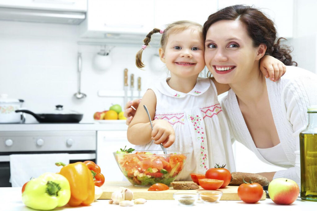 mom teaches daughter to cook food