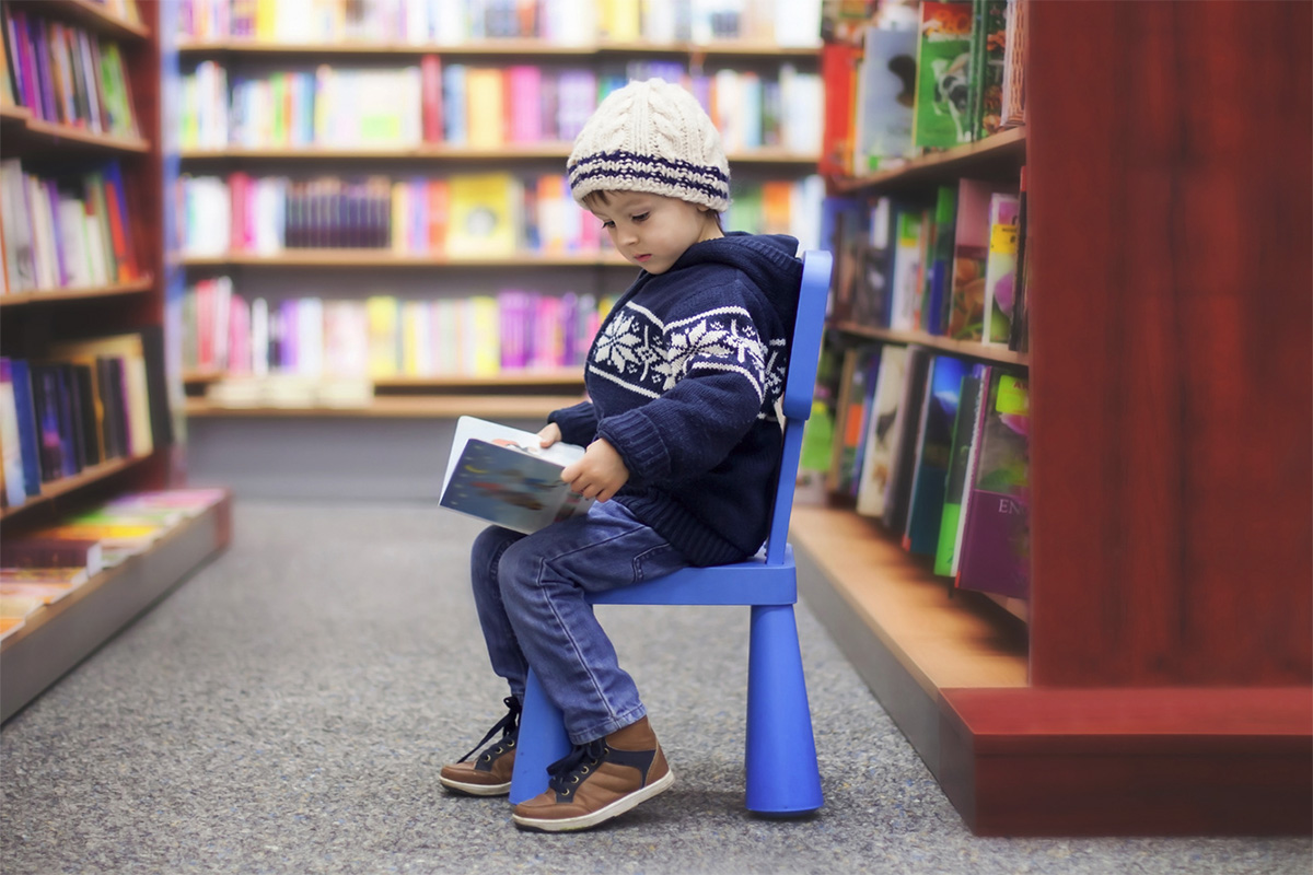 child reading at library