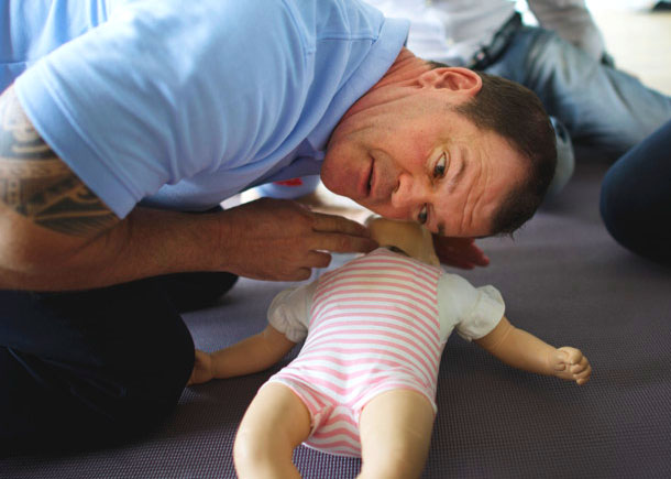 performing infant CPR