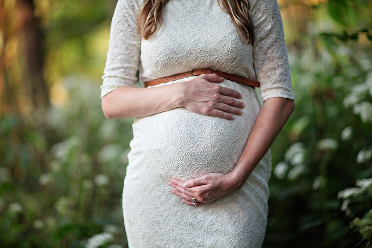 Pregnant Woman Holding Tummy